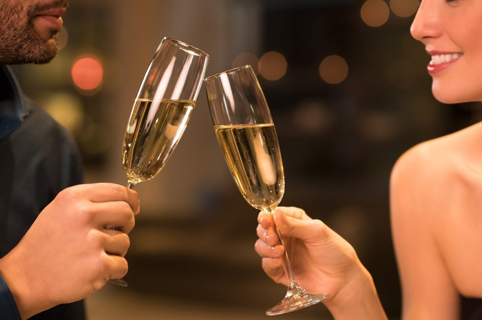 Couple toasting with champagne at a restaurant