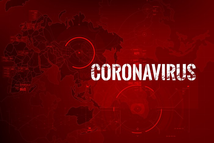 The word Coronavirus over a blurred world map with some hot spots circled