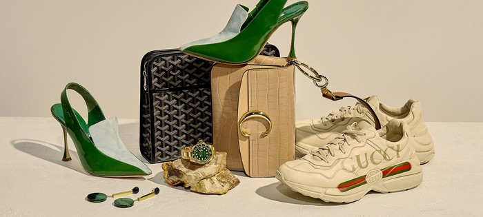 An assortment of pre-owned luxury items: shoes, handbags, and jewelry.
