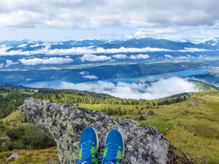 A vast landscape with a pair of athletic shoes appearing at the bottom.
