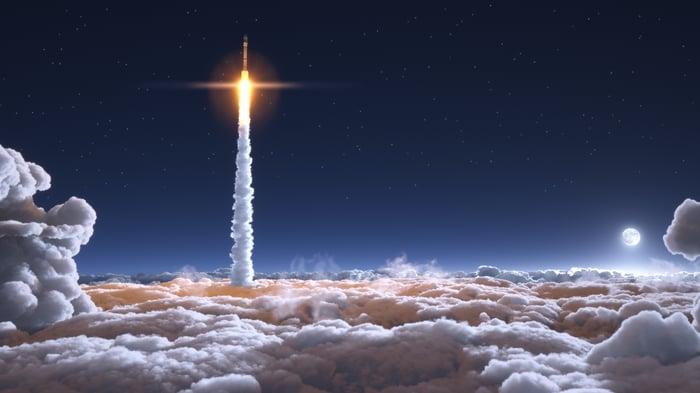 Rocket launching against night sky