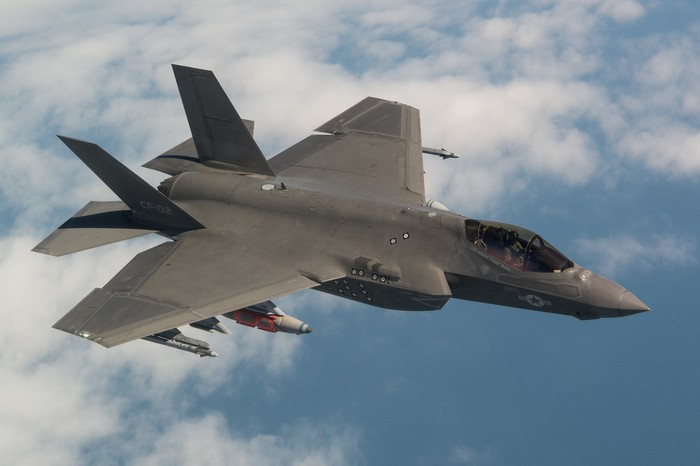 A F-35 soars over the clouds.