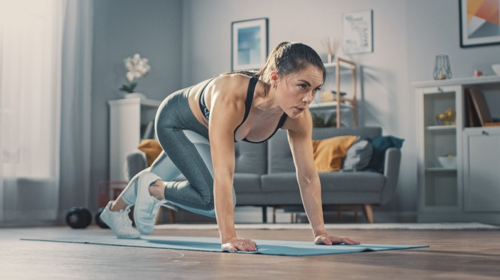 A woman works out at home.