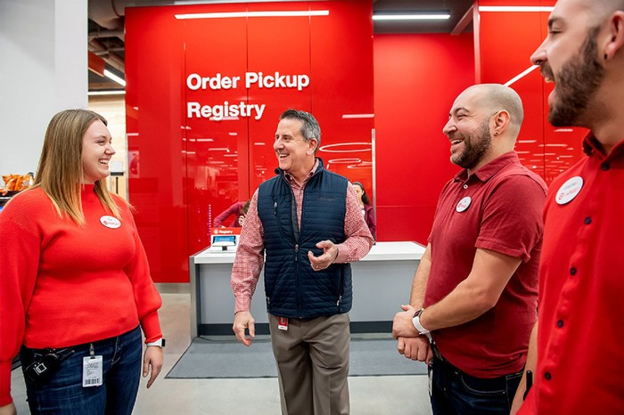 Target CEO Brian Cornell and workers.