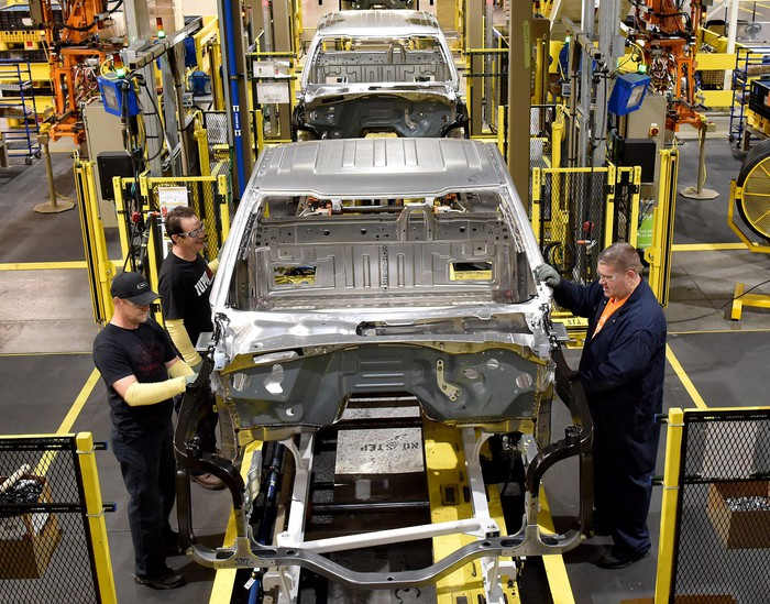 Workers tend to partially assembled pickups at Ford's Kentucky Truck Plant in Louisville, KY.