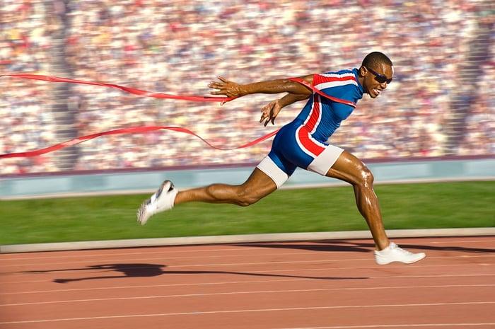 Runner crossing finish line.