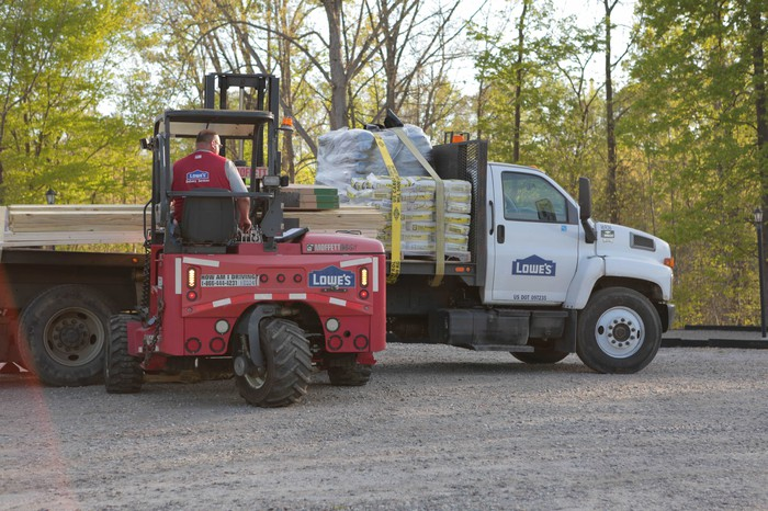 A Lowe's truck and forklift.