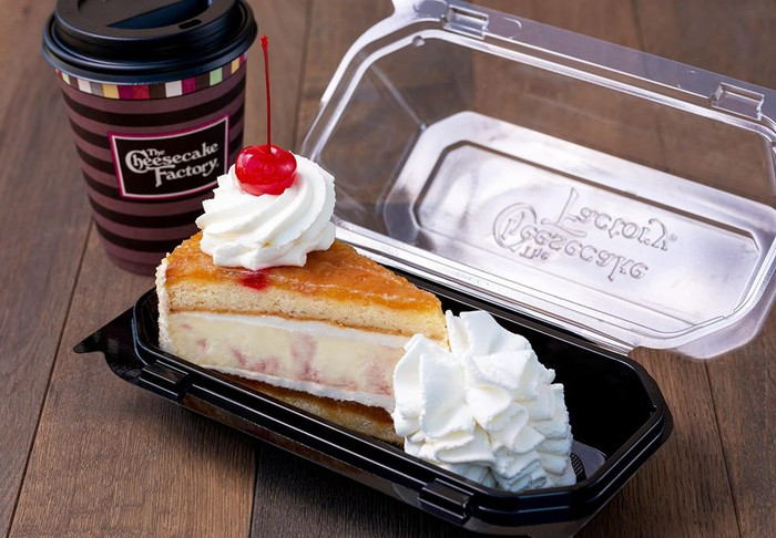 A slice of cheesecake and a coffee from The Cheesecake Factory.