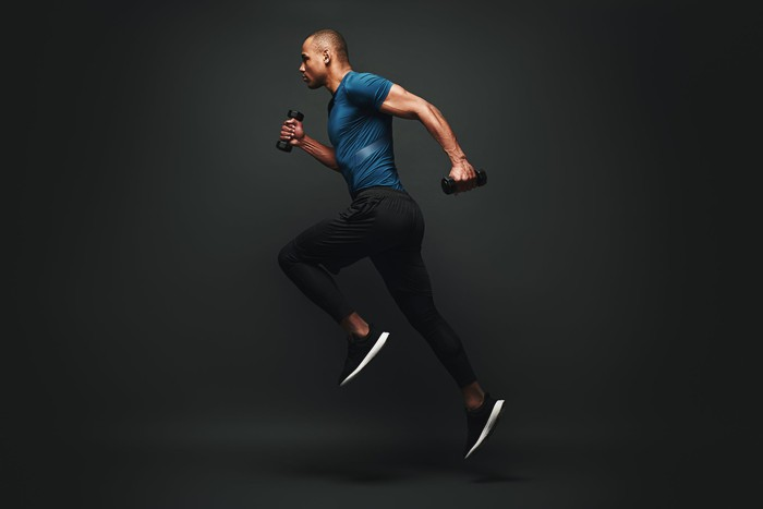 A man running while holding weights