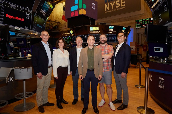 Slack executives at the New York Stock exchange on the day of the company's direct listing.