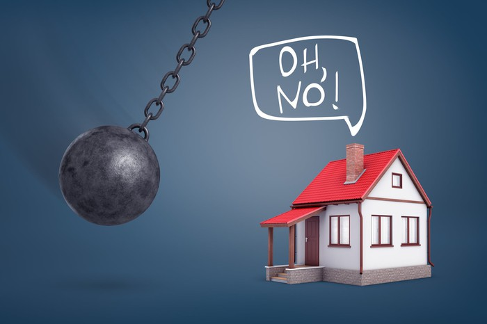 """A house says, """"Oh, no!"""" as a wrecking ball swings towards it."""