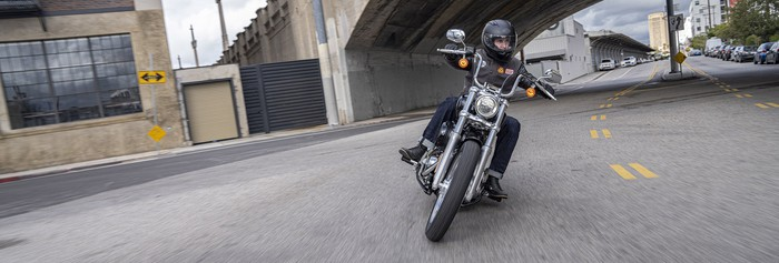 Man riding a Harley-Davidson motorcycle.