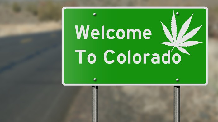 Welcome to Colorado road sign with marijuana leaf.