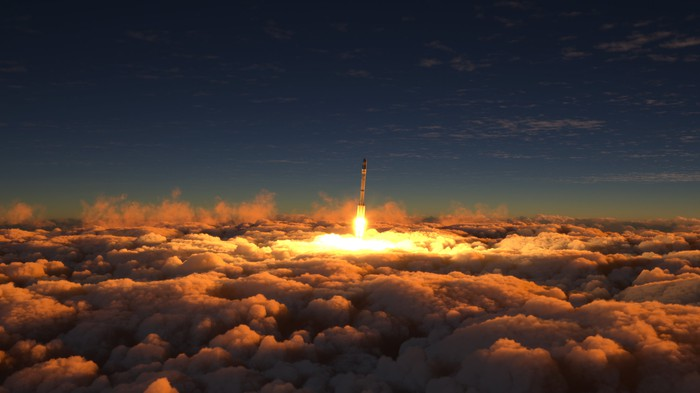 A rocket flies above the clouds at sunset.