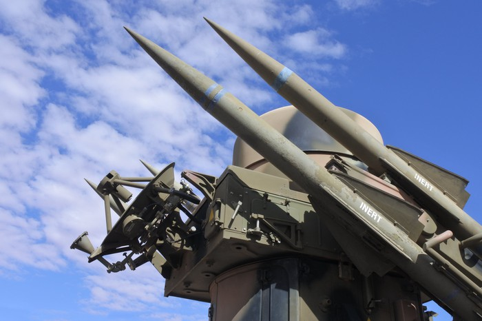 Missile and radar system against blue sky
