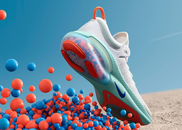 A Nike Joyride shoe with cushioning beads pictured underneath it.