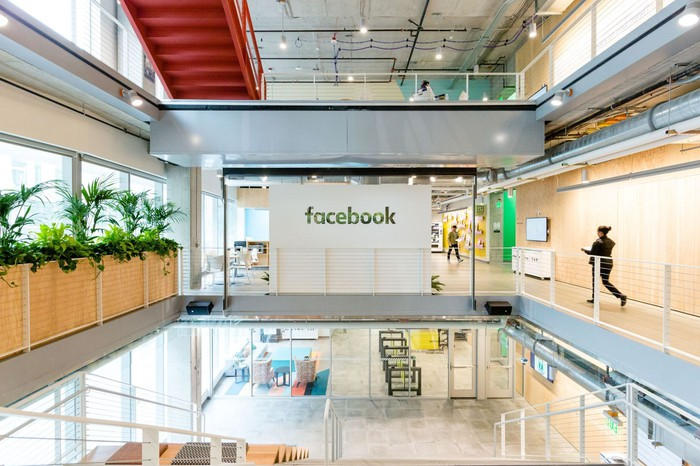 Facebook's atrium in the Seattle office with natural light coming in the windows.