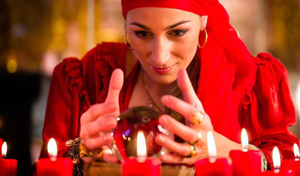 Fortune teller with crystal ball -- GettyImages-690191968