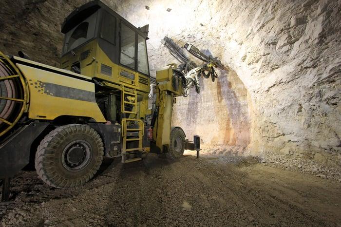 An excavator operating in an underground mine.