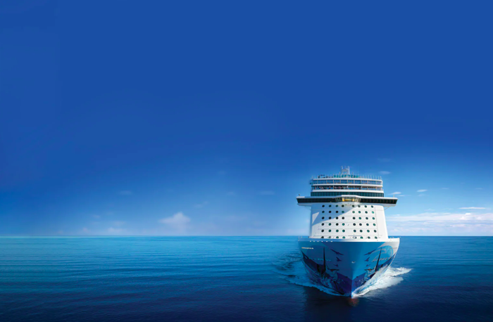 Rendering of a Norwegian Cruise Line ship coasting on a blue sea against a blue sky.