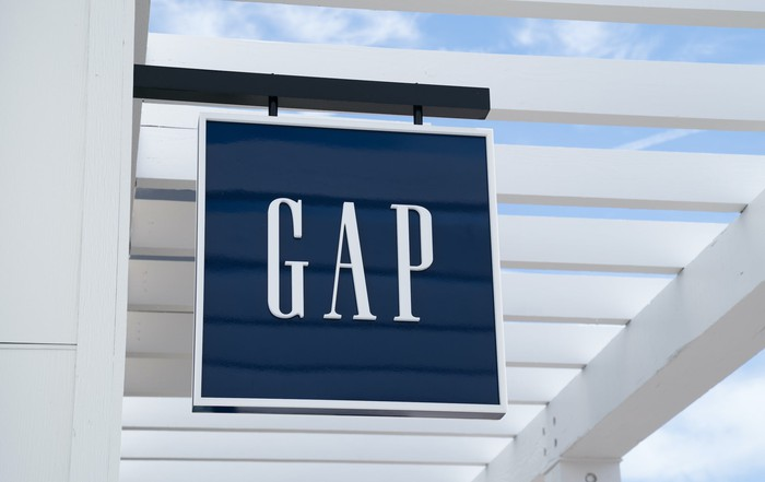 A blue Gap store sign with white lettering