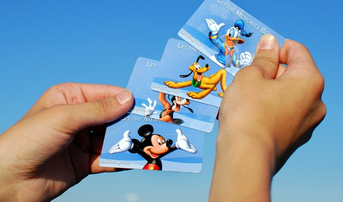 A collection of Disney parks admission cards.