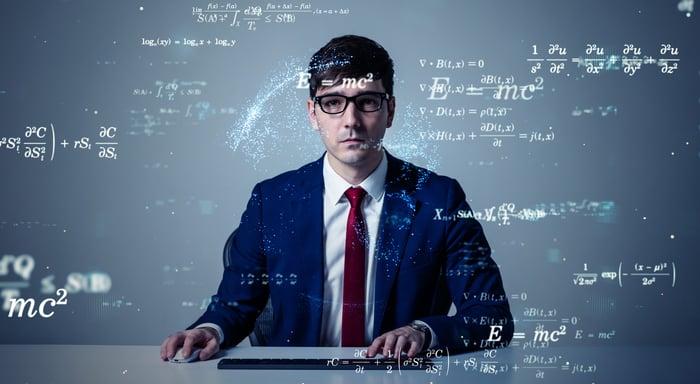 College professor with complex formulas surrounding him