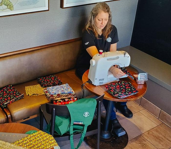 Heather Staples sews masks inside a Starbucks.