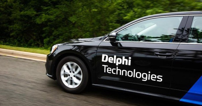 A test car with the Delphi Technologies logo on the side.