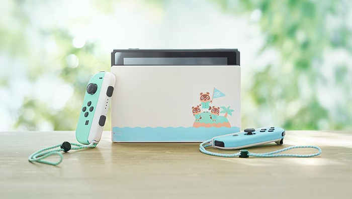 Nintendo Switch special edition themed after Animal Crossing, with three cute animals printed on the side of the hardware, which is colored in pale green and blue