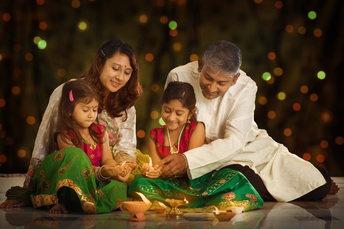 An Indian family opens gifts on Diwali.