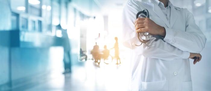 A medical professional in a hospital hallway.