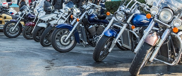 Motorcycles parked in a row.