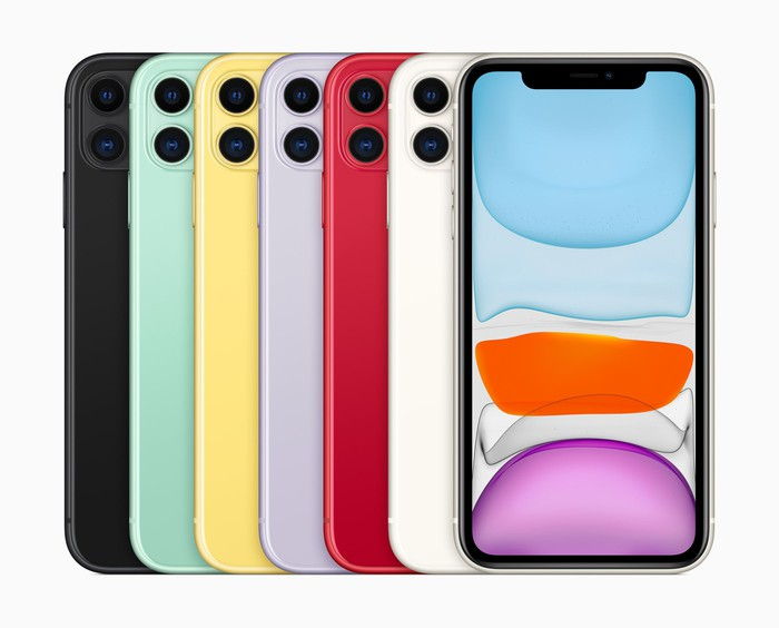 Seven iPhone 11s in different colors are lined up in a row