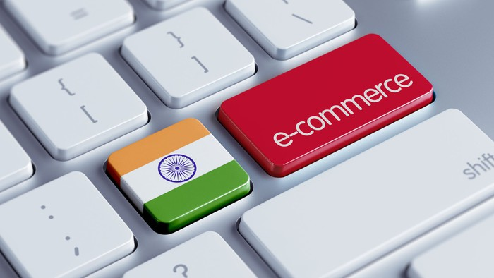 A computer keyboard with one key showing the Indian flag and another with the word e-commerce on it