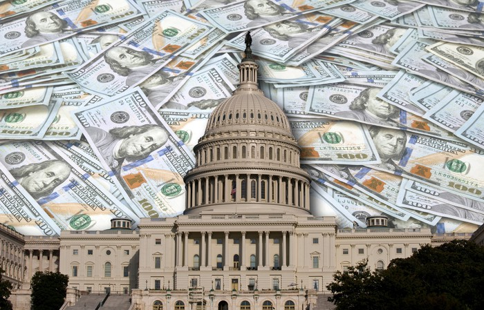 U.S. Capitol building with $100 bills in the background
