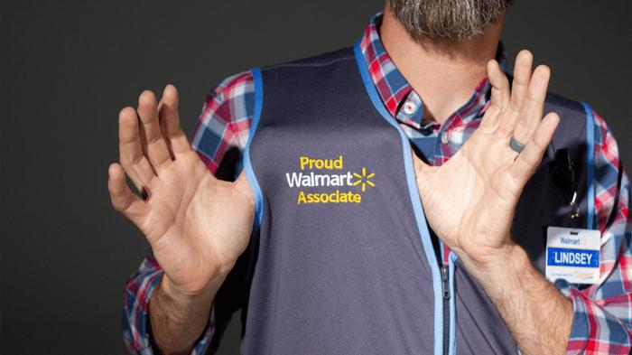 A closeup shot of a Walmart worker.