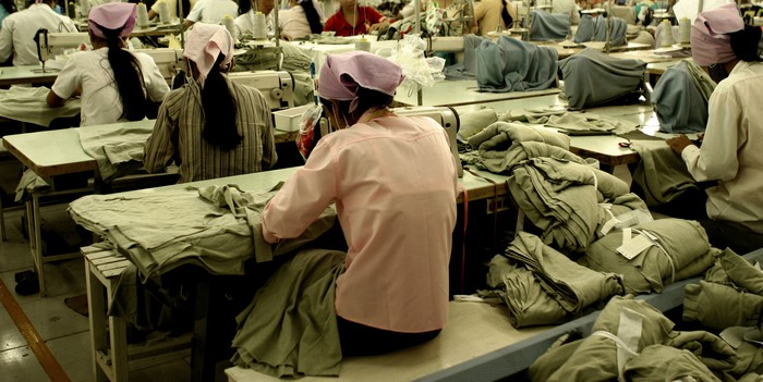 Garment factory workers sewing in a factory