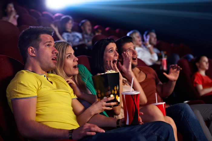 Moviegoers reacting with horror to film