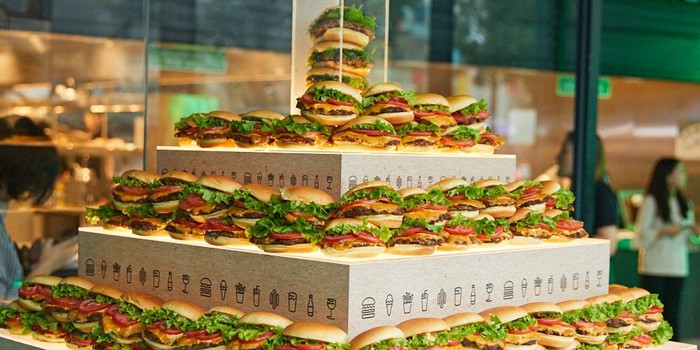 A tower of Shake Shack hamburgers.