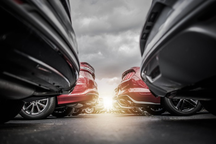 Rows of vehicles at a new-car dealership.