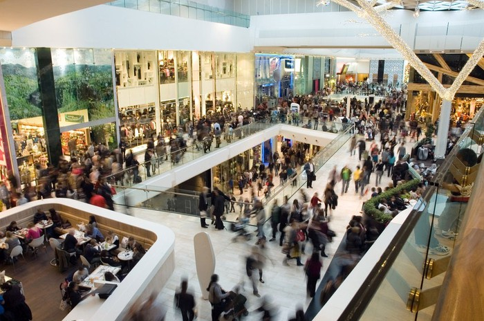 Crowd of people in a mall.