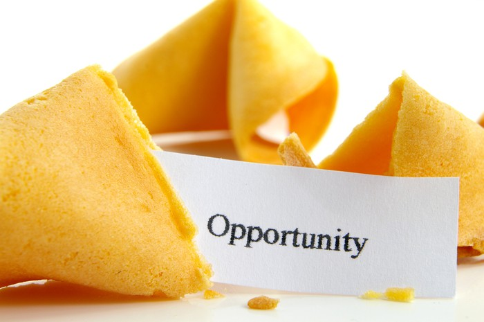 Open fortune cookie says Opportunity on fortune
