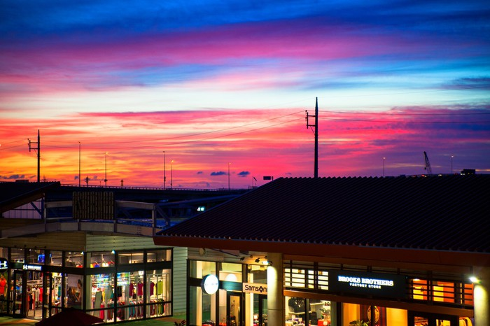 Picture of an outlet mall at sunset.