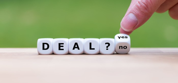 "Letter dice spelling ""Deal? Yes/No"""