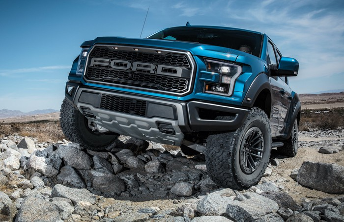 A 2020 Ford F-150 Raptor, a high-performance off-road pickup, shown on rocky terrain.