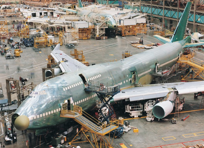 A plane under construction on the assembly line.