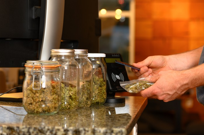 A person buys cannabis at a dispensary with a credit card