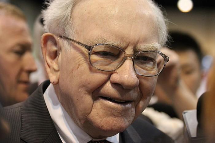 Similing Warren Buffett.