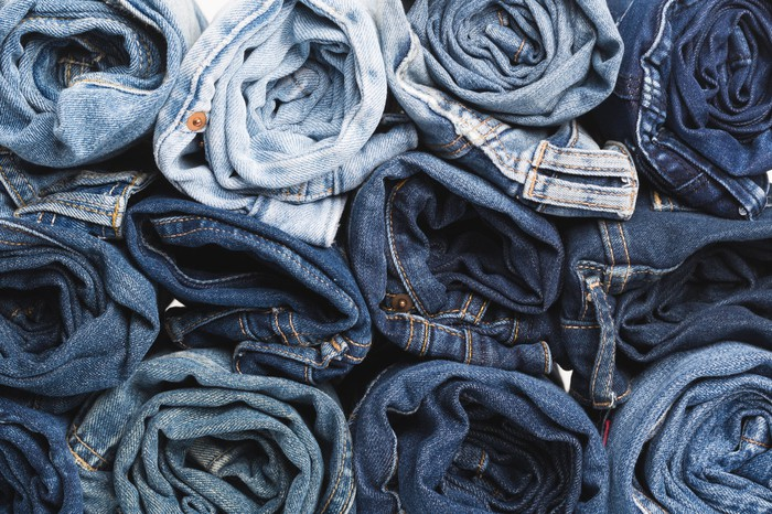 Several stacks of rolled-up jeans.